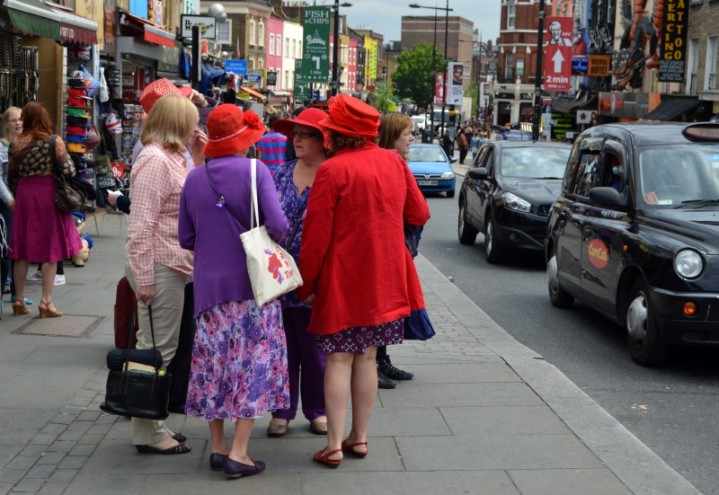 Red hatters chatting in London