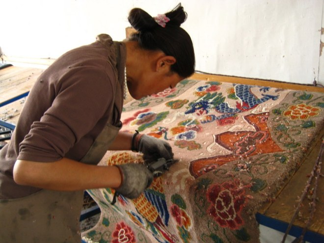 Cutting Tibetan carpets
