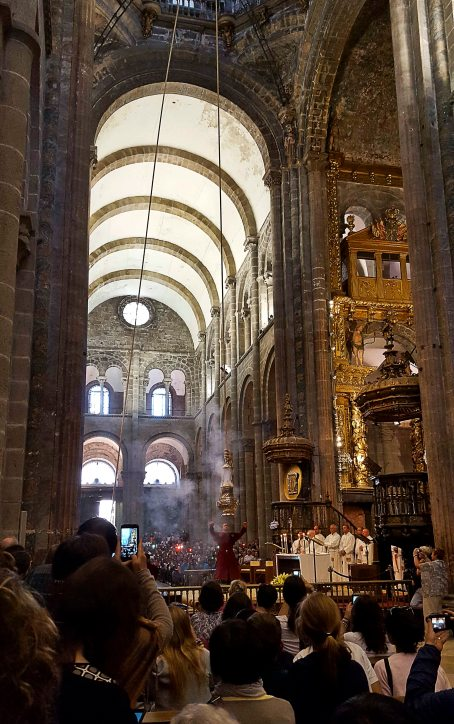 The Botafumeiro is filled with incense...