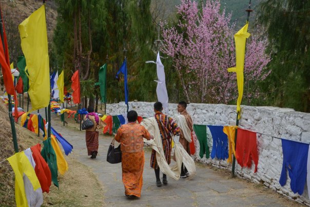 Flags flying the whole way up to the dzong