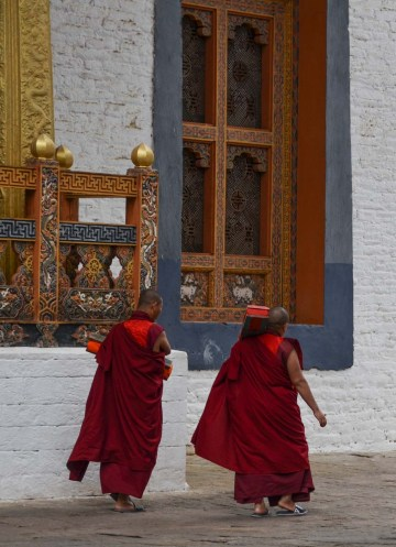 ...two of the monks carrying the books, the scripture rolls, back.
