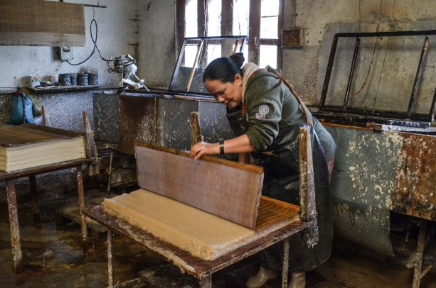 Two or three people work in this little factory in Thimpu