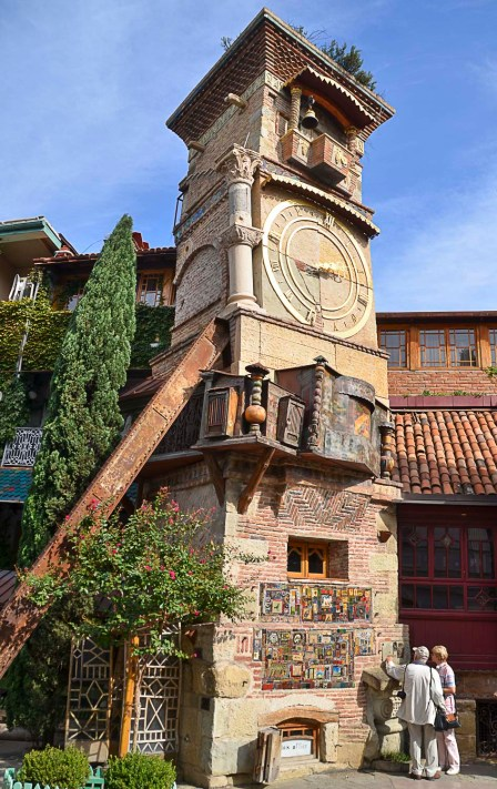 The leaning clock tower was created by the renowned Georgian puppeteer Rezo Gabriadze. On the hour, a window opens at the top and an angel strikes the bell. Below the clock, a screen opens and shows the circle of life: boy meets girl, marriage, childbirth and funeral.